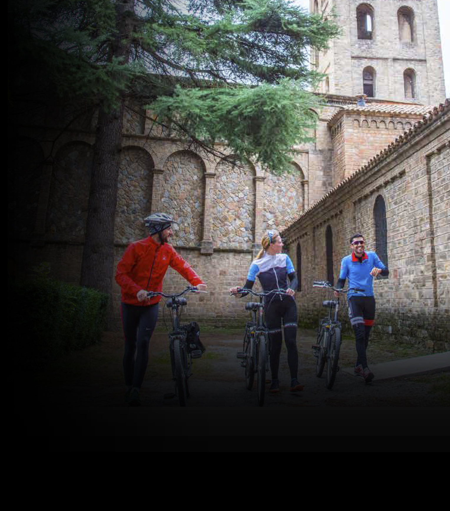 Cyclists in the monastery of Ripoll