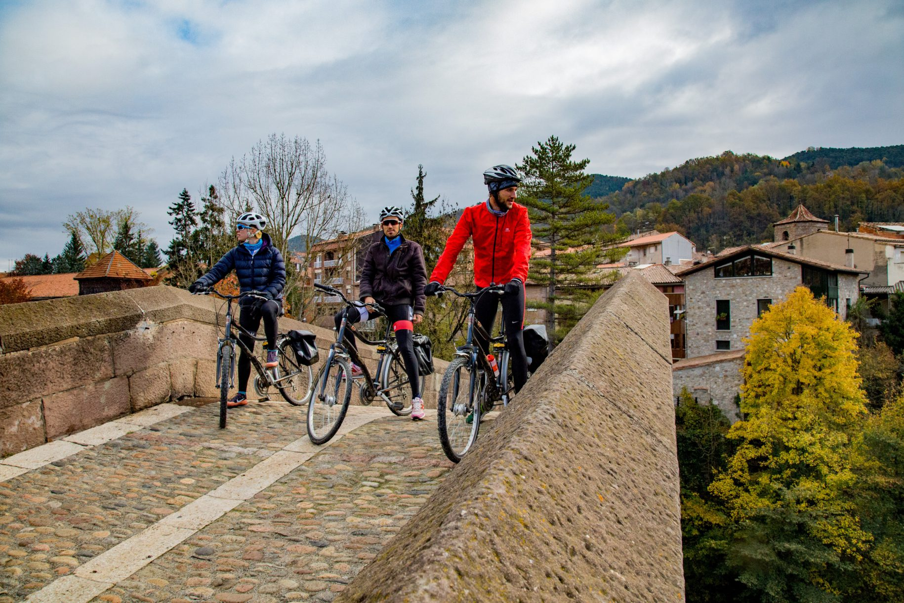 Cyclists on the bridge of Sant Joan de les Abadesses