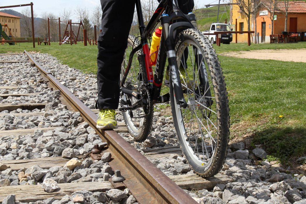 Bike wheels on railway tracks in Sant Joan Abadesses