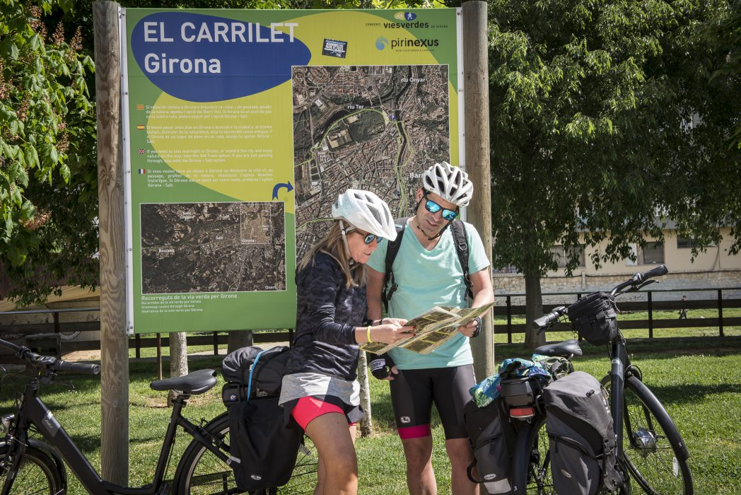 Cyclists checking a map, Carrilet II Route