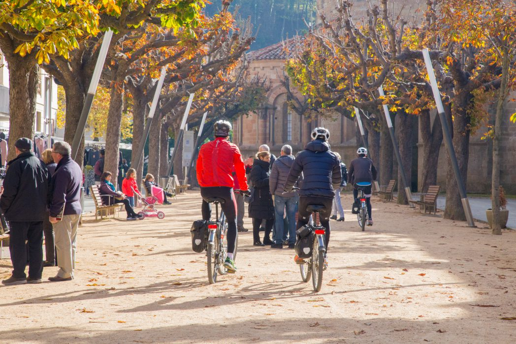 Cyclists pedaling in Sant Joan de les Abadesses