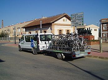 Bicycle touring van with a trailer full of bikes