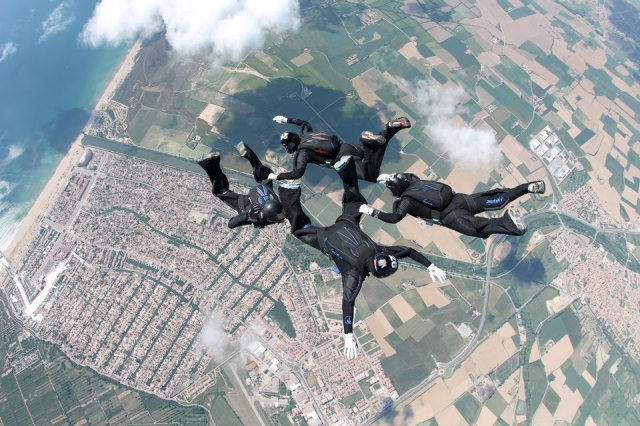Skydivers above Roses